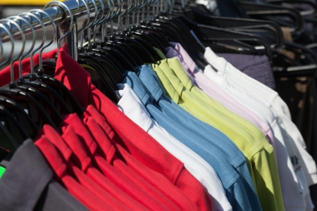 Multicolored shirts on hanger at store photo