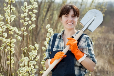 Female farmer  with shovel in spring outdoor photo