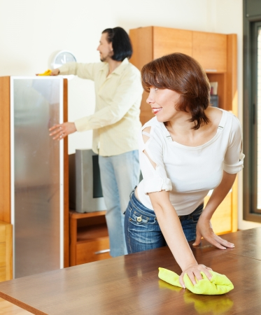 woman with husband cleaning   room photo