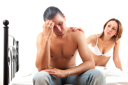 Middle-aged girl consoling the depressed husband in bed at home Stock Photo - 23332105