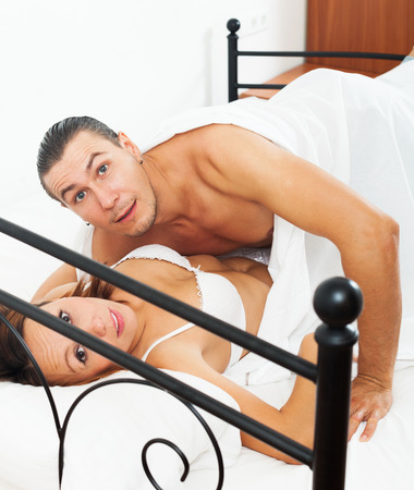 Frightened  man and woman during sex in bed photo