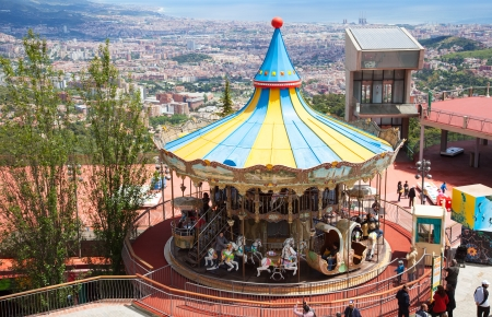BARCELONA, SPAIN - MAY 18: Carrousel at Tibidabo Amusement Park in May 18, 2013 in Barcelona, Spain.  Park area of 70,000 square meters meters and is the oldest amusement park in Spain