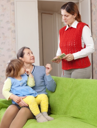mother leaving baby with nanny at home photo