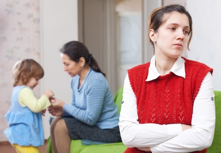 fracas: Sad young mother against grandmother and granddaughter