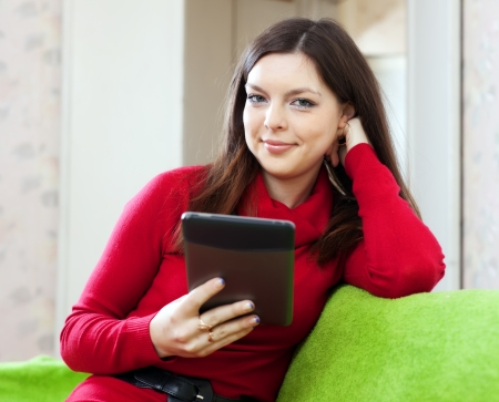 woman using tablet computer or electronic book at home photo