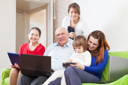 Happy family  or group of friends with electronic devices photo