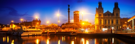 Panoramic view of Columbus Quay from Port Vell in night time. Barcelona