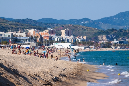 3rd century: BADALONA, SPAIN - JUNE 12: Sea sand beach in June 12, 2013 in Badalona, Spain.  City was founded by the Romans in the 3rd century BC. Now it is one of the centers of a beach holiday Editorial