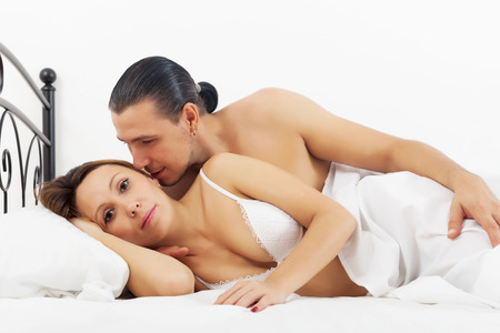 awaking: Middle-aged couple awaking in bed at bedroom Stock Photo