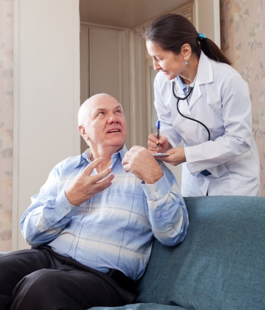 malaise: mature man tells the doctor the symptoms of malaise on couch