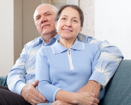 mature couple: Happy  mature couple on sofa in home Stock Photo