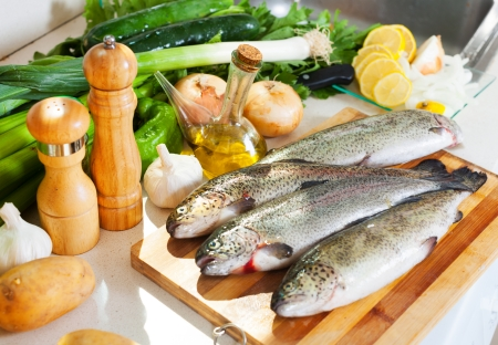 brook trout:  fresh trout fish in kitchen