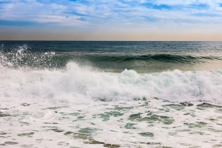 sputter: Spray of the surf on windy day Stock Photo
