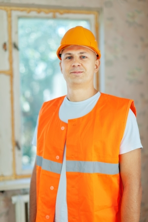 unskilled worker: Portrait of builder at construction site