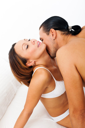 couple kissing and playing in bed  photo