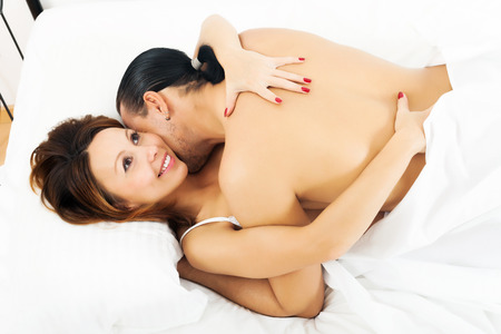 man and woman sex: Happy woman having sex with man Stock Photo