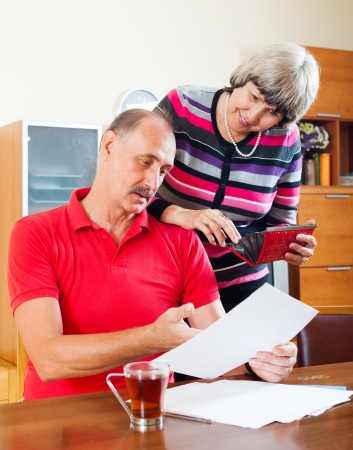 senior family  with financial documents at home   photo