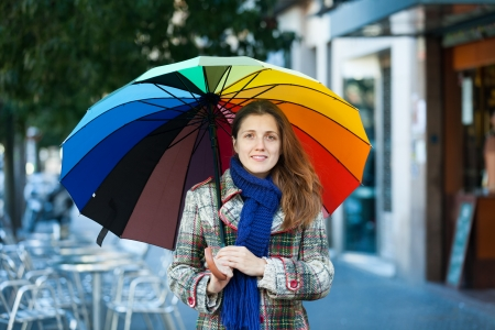 happy seasonable: Portrait of beauty girl with umbrella  in autumn street