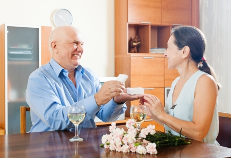 Happy mature couple having romantic date at home photo