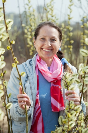 portrait of happy mature woman in spring