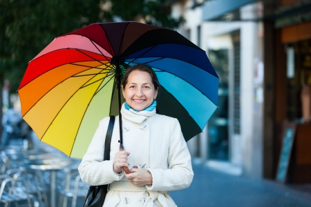 ordinary woman: laughing mature woman with umbrella in autumn Stock Photo
