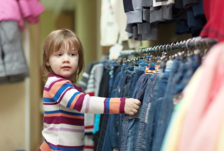 hellion: 2 years child  chooses jeans at clothes shop