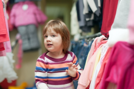 hellion: Baby girl  chooses dress at clothes shop