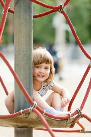 adroitness: child  on ropes at playground area