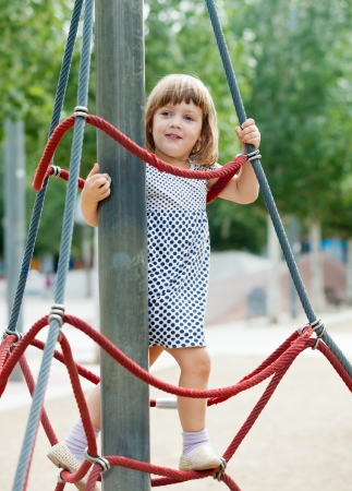 adroitness:  child on ropes at playground area in summer Stock Photo
