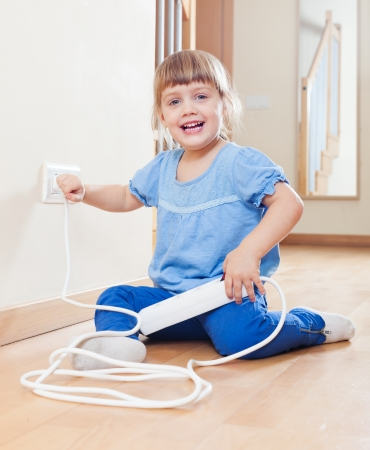 riskiness: three year old child playing with electricity
