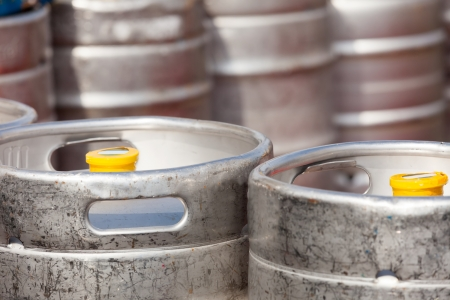 beer barrel: aluminum barrel beer kegs in rows outdoor Stock Photo