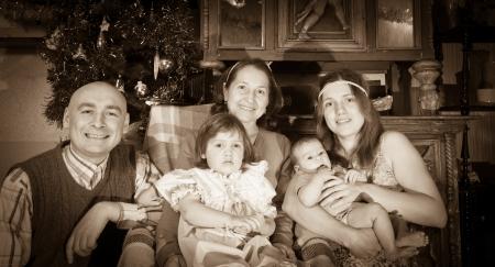 Imitation of ancient photo of Christmas portrait of happy family  photo