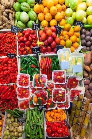 bushel:  chili pepper and other vegetables on spanish market  Stock Photo