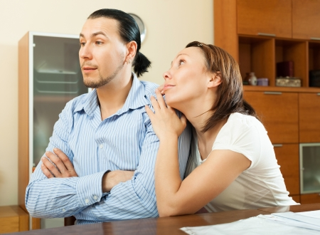 Adult couple having quarrel about documents photo