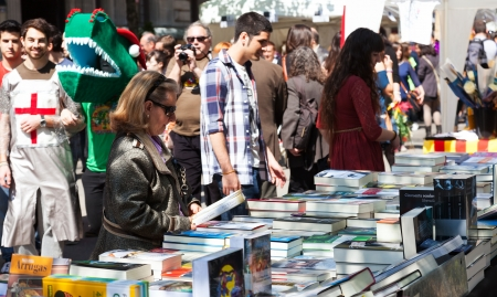 christian festival: BARCELONA, SPAIN - APRIL 23: People looking books  in St. George day in April 23, 2013 in Barcelona, Spain. Books and red roses is traditionally gifts of festival