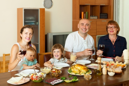 Portrait of happy multigeneration family posing together over festive table