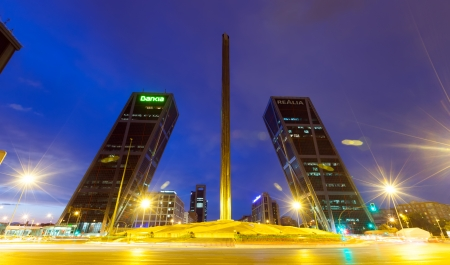 MADRID, SPAIN - AUGUST 28: Plaza de Castilla in night on August 28, 2013 on August 28, 2013 in Madrid, Spain.  Caja Madrid Obelisk and KIO towers