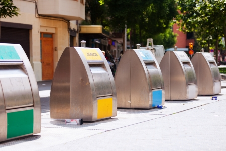 dumptruck: garbage cans for separation of rubbish at city street Stock Photo