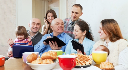 mobile home:  family of three generations or group of friends with electronic devices  Stock Photo