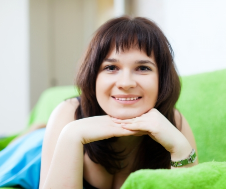 ordinary woman: ordinary woman lying on couch in livingroom room