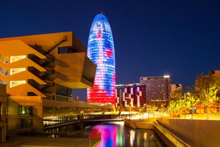 BARCELONA, SPAIN - APRIL 12  Torre agbar skyscraper in night  in April 12, 2013 in Barcelona, Spain  38 storey skyscraper, built in 2005 by Jean Nouvel  Now one of the symbols of Barcelona is owned by Grupo Agbar