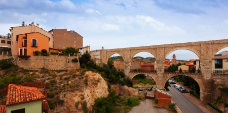 acueducto: Los Arcos aqueduct in summer  Teruel, Spain Editorial