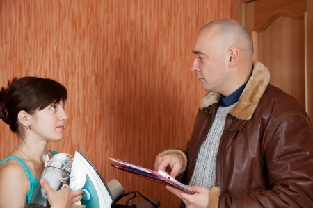 businessman trying to collect debt  from woman photo