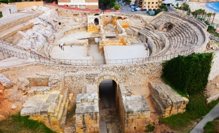 ancient Roman amphitheater at Mediterranean. Tarragona, Spain Editorial