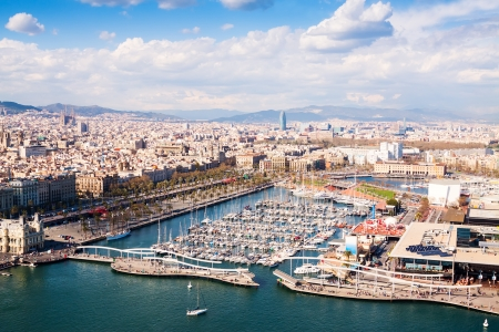Aerial view of Barcelona city with Port Vell in cloudy day.Spain Stock Photo