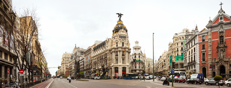 gran via: MADRID, SPAIN - APRIL 26  Panorama of Crossing the Calle de Alcala and Gran Via in April 26, 2013 in Madrid, Spain   It is most important avenues at city