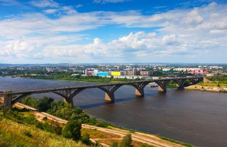 View of Nizhny Novgorod with Molitovsky bridge through Oka River. Russia photo