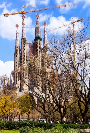 uncomplete: BARCELONA, SPAIN - MARCH 28: Sagrada Familia in March 28, 2013 in Barcelona, Spain. Basilica and Expiatory Church of the Holy Family by Gaudi, building is begun in 1882 and completion is planned in 2030