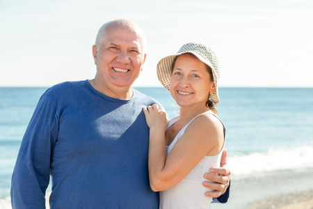 positive mature couple at sea vacation photo