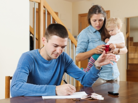 parsimony: Family of three with baby having quarrel quarrel over money at home